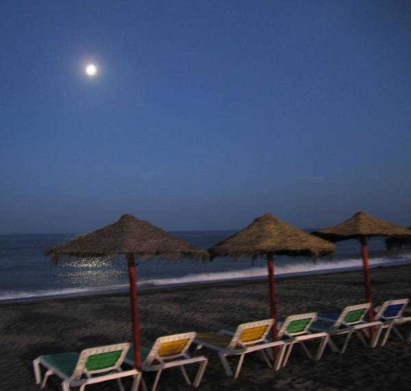 Photograph - Beach Umbrellas Under The Moon Costa Del Sol Spain by John Shiron