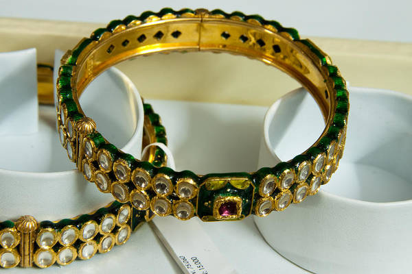 Jewelery Photograph - Beautiful Green And Purple Covered Gold Bangles With Semi-precious Stones Inlaid by Ashish Agarwal