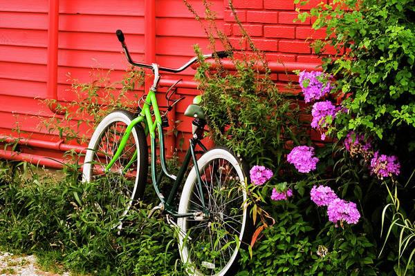 Photograph - Bike On A Wall by Tom Singleton