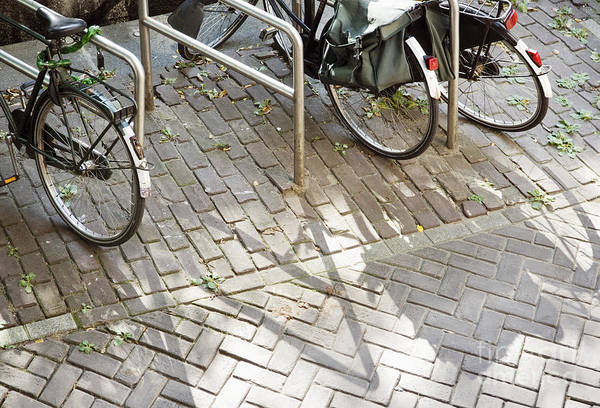 Bicycle Rack Photograph - Bikes Parked At Racks by Andersen Ross