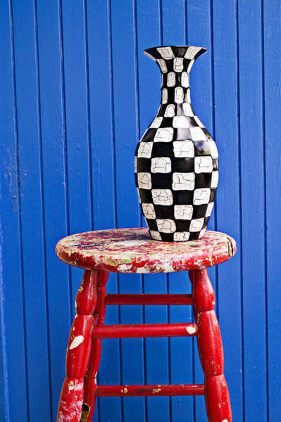 Blue Vase Photograph - Blach And White Vase On Stool Against Blue Wall by Garry Gay
