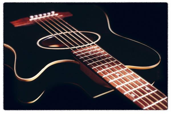 Acoustic Guitar Photograph - Black Acoustic Guitar by Mike McGlothlen
