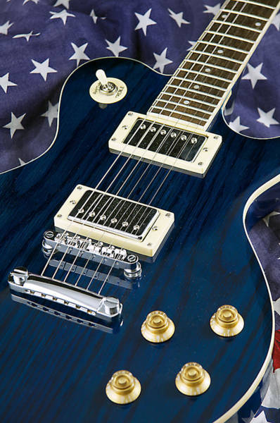 Photograph - Blue Guitar On Flag Background by M K Miller
