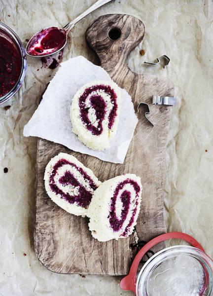 Vertical Line Photograph - Board Of Raspberry Dessert Rolls by Cultura/Line Klein