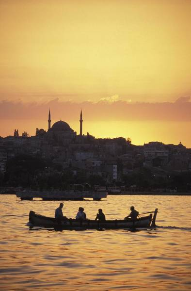 Silhoutte Photograph - Boat On The Bosphorus At Sunset by Axiom Photographic