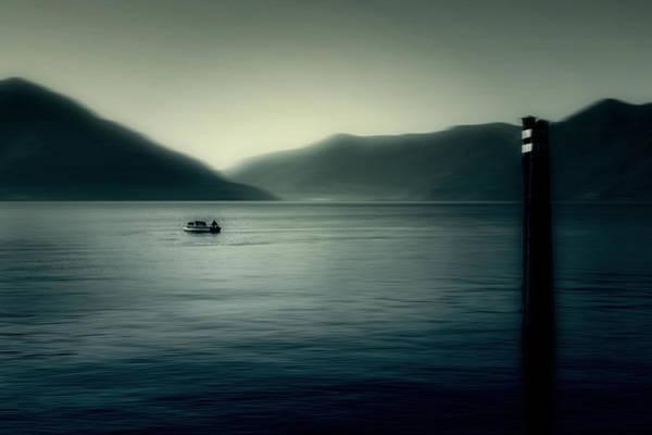 Lake Maggiore Photograph - boat on the Lake Maggiore by Joana Kruse