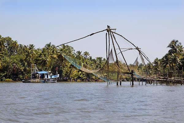 Bankside Photograph - Boat Sails Past Fishing Nets by Kantilal Patel