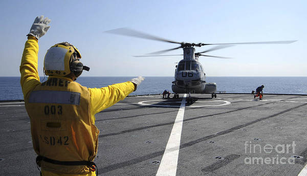 Flight Deck Photograph - Boatswain's Mate Directs A Ch-46 Sea by Stocktrek Images
