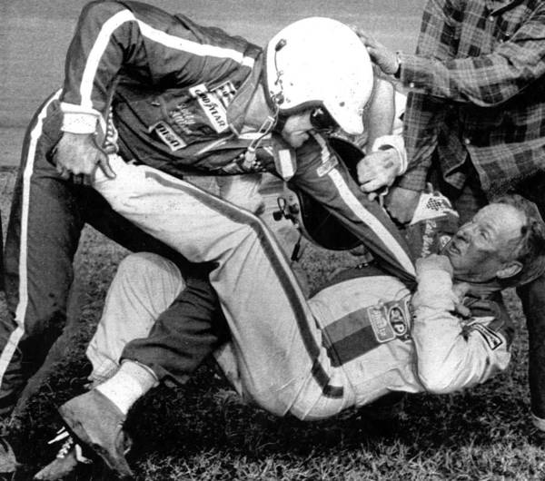 Allison Photograph - Bobby Allison Lfights With Cale by Everett