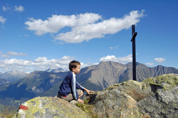 Photograph - Boy On Mountain Top Looking At Cross by Matthias Hauser
