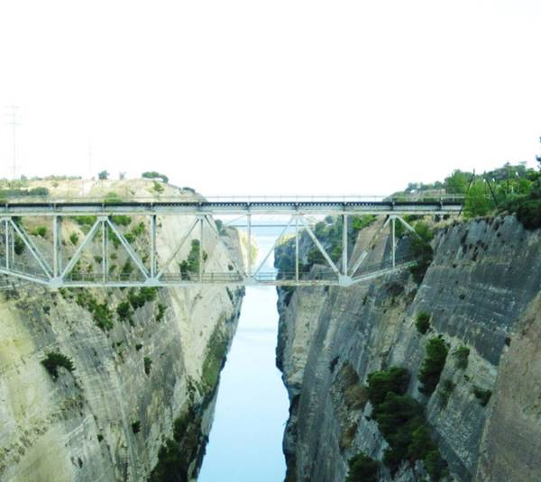 Photograph - Bridge Crossing Corinth Canal In Greece by John Shiron