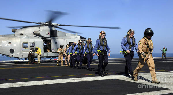 Agustawestland Photograph - British Sailors Are Escorted Off An by Stocktrek Images