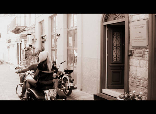 Photograph - Girl Riding Motorcycle II With Handsome Bike Rider Speed Stone Paved Street Nafplion Greece by John Shiron