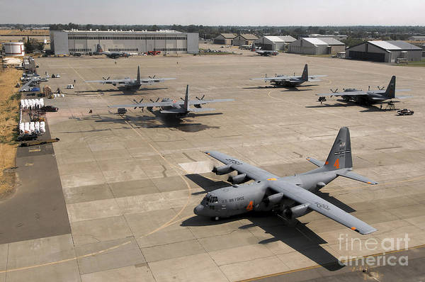 Taxiway Wall Art - Photograph - C-130 Hercules Aircraft Stationed At An by Stocktrek Images