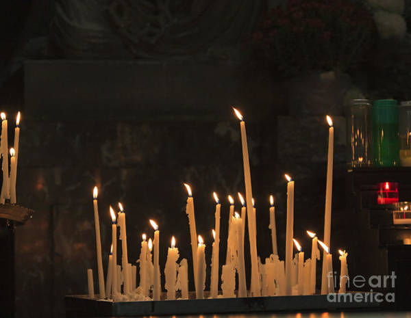 Taper Photograph - Candles Burning In A Church In Front Of A Shrine by Louise Heusinkveld