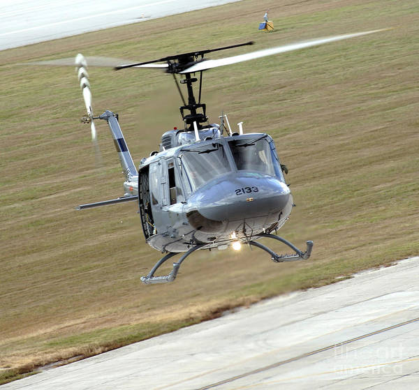 Utility Aircraft Photograph - Captain Pilots The Th-1h Trainer by Stocktrek Images