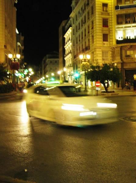 Photograph - Car Speeding Thru The Streets Of Granada Spain At Night by John Shiron