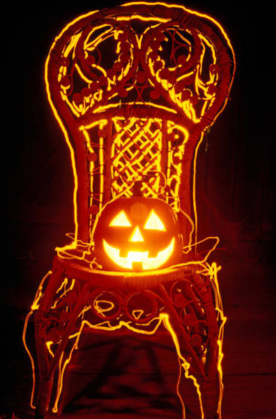 31st Photograph - Carved Smiling Pumpkin On Chair by Garry Gay