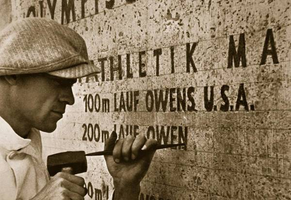 Sportsmen Photograph - Carving The Name Of Jesse Owens Into The Champions Plinth At The 1936 Summer Olympics In Berlin by American School