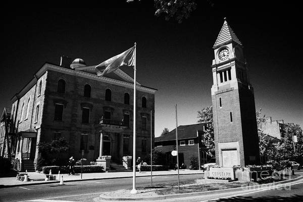 Courthouse Towers Wall Art - Photograph - Cenotaph Clock Tower And Old Court House On Queen Street Niagara-on-the-lake Ontario Canada by Joe Fox