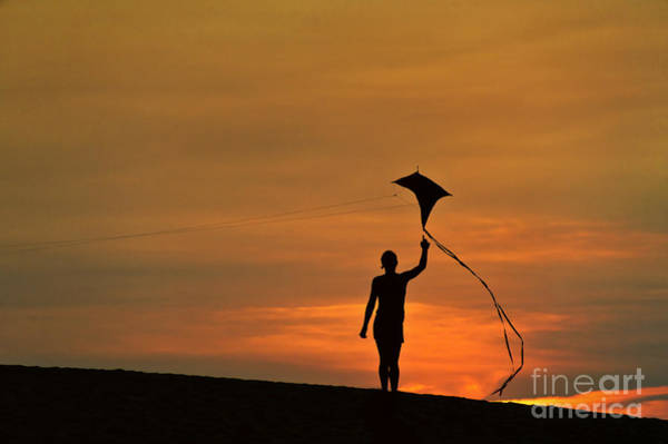 Flying A Kite Photograph - Child Flying A Kite by John Greim