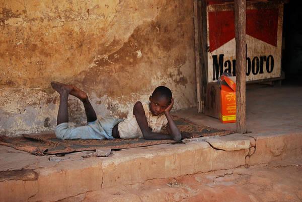 Dakar Photograph - Child In The Street by Kamel Rekouane