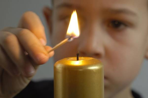 Photograph - Child Lights A Candle by Matthias Hauser