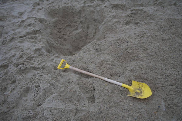 Rehoboth Beach Photograph - Childs Shovel And Hole In The Sandy by Stephen St. John