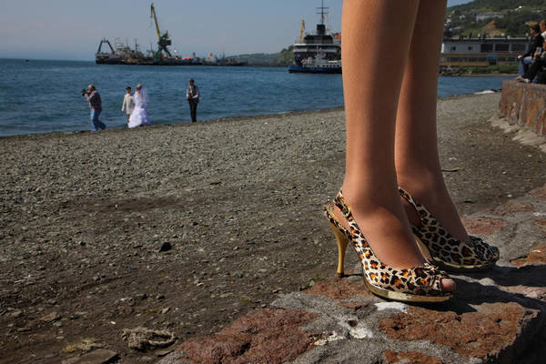 Kamchatka Photograph - Chinese-made Shoes Worn By A Bridesmaid by Randy Olson
