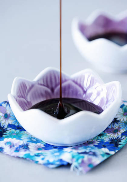 Vertical Line Photograph - Chocolate Sauce Pouring Into Cup by Cultura/Line Klein