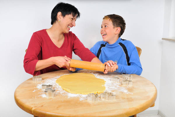 Photograph - Christmas Baking - Mother And Son Laughing by Matthias Hauser