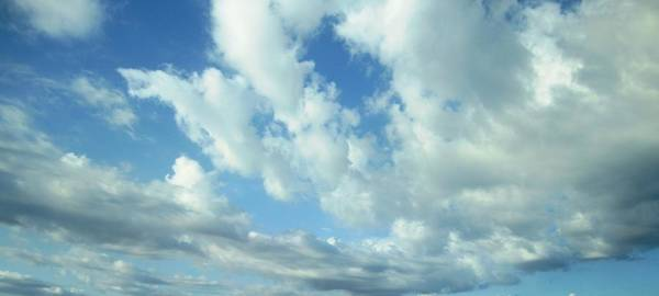 Photograph - Cloudy Blue Sky In Greece by John Shiron