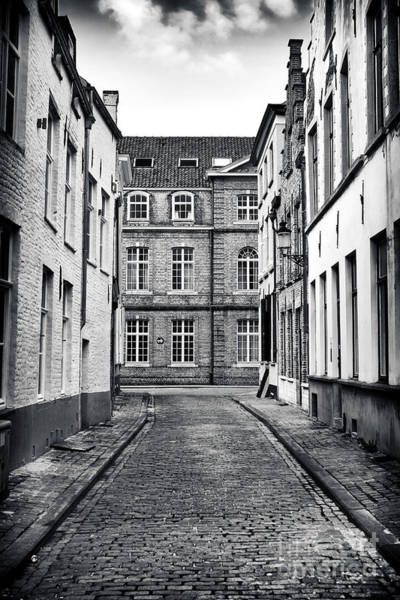 Wall Art - Photograph - Cobblestone Walk In Bruges by John Rizzuto