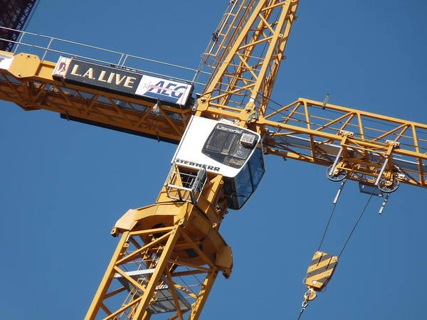 Photograph - Construction Crane by Jeff Lowe