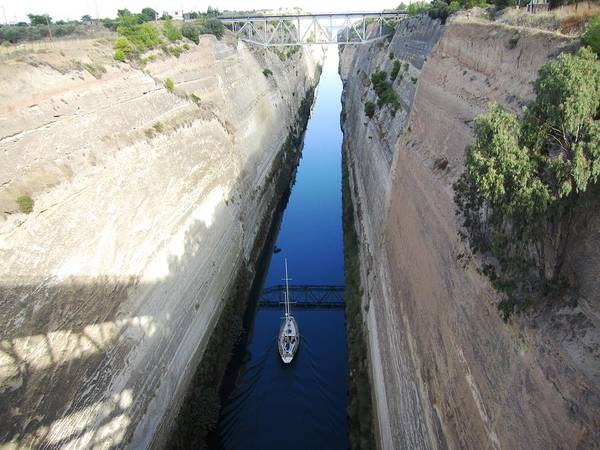 Photograph - Corinth Canal Bridge Crossing And Sailboat In Greece by John Shiron