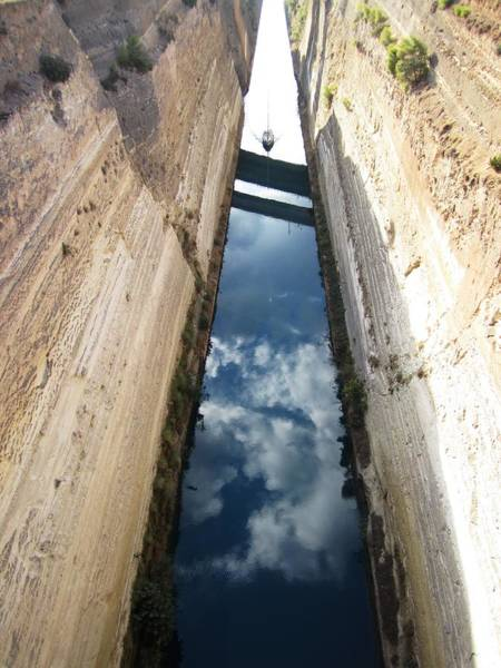 Photograph - Corinth Canal Sail Boat And Sky Reflection In Water In Greece by John Shiron