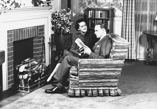 Armchair Photograph - Couple Sitting On Armchair In Front Of Fireplace, (b&w) by George Marks