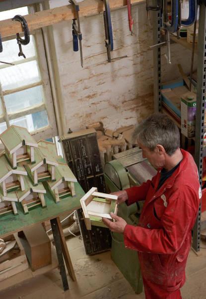 Craftsperson Photograph - Craftsman Inspecting Work by Michael Blann