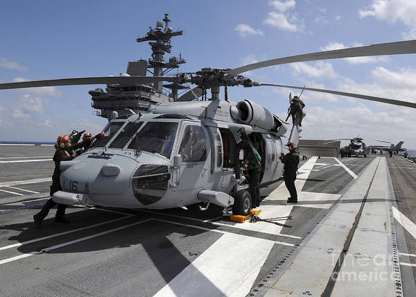 Uss George H W Bush Wall Art - Photograph - Crewmen Prepare An Mh-60s Sea Hawk by Stocktrek Images