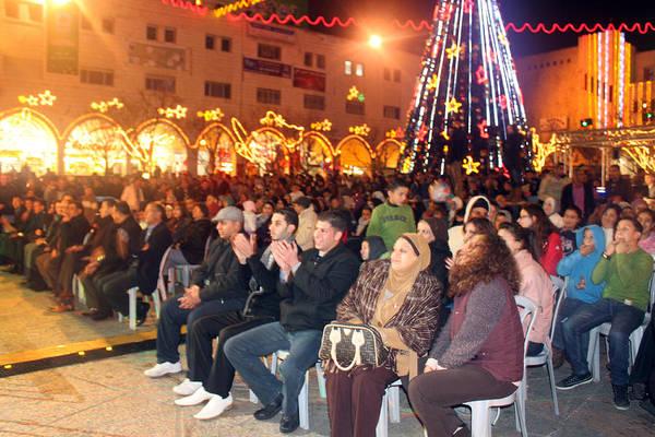 Manger Photograph - Crowds At 1st Nativity International Christmas Festival by Munir Alawi
