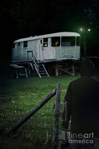 Photograph - Dark Fiqure At Night In Front Of Old Mobile Trailer by Sandra Cunningham