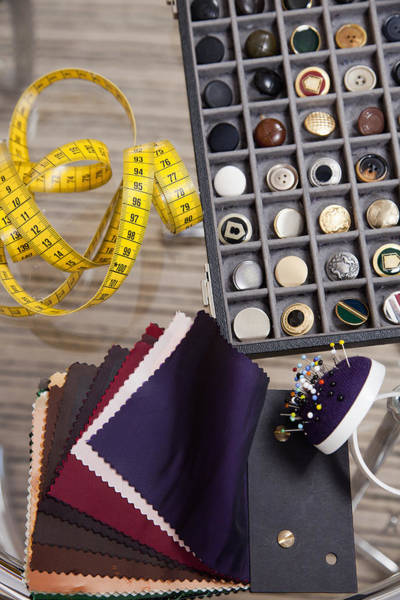 Cushion Photograph - Detail Of Fabric Samples, Buttons, And Other Sewing Equipment by Paul Hudson