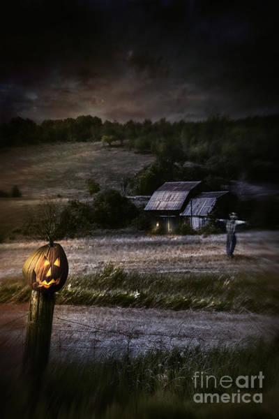 Photograph - Eerie Night Scene With Halloween Pumpkin On Fence by Sandra Cunningham