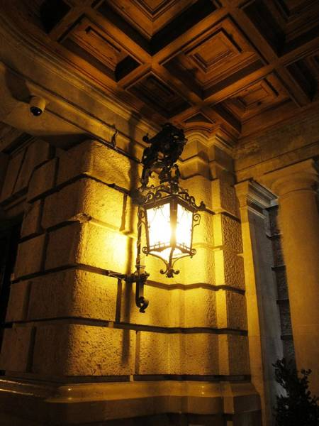 Photograph - Elegant Antique Looking Lamp Post At Night In Valencia Spain by John Shiron