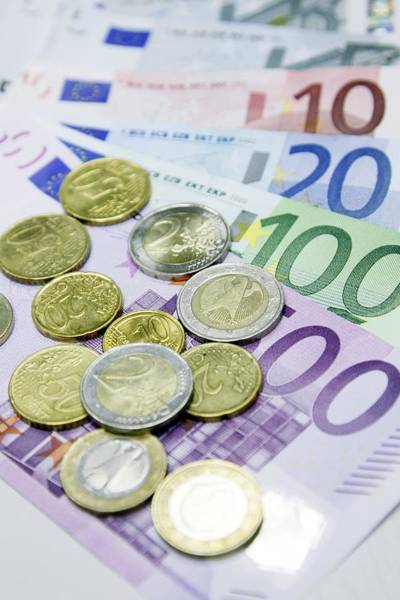Legal Tender Photograph - Euros In Notes And Coins by Ria Novosti