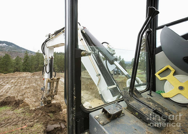 Excavator Photograph - Excavator At A Construction Site by Andersen Ross