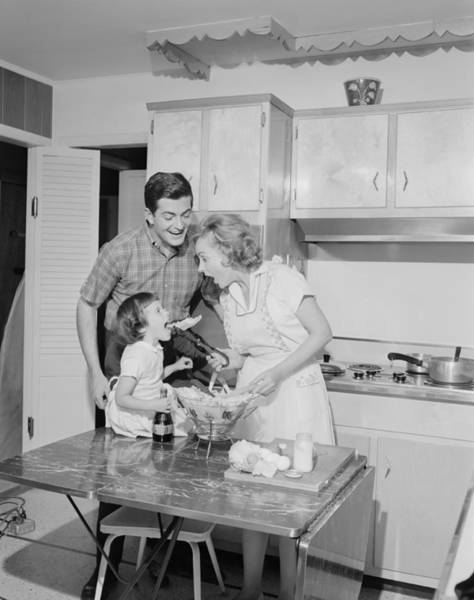 Family With Daughter (2-3) Preparing Food In Kitchen Art Print