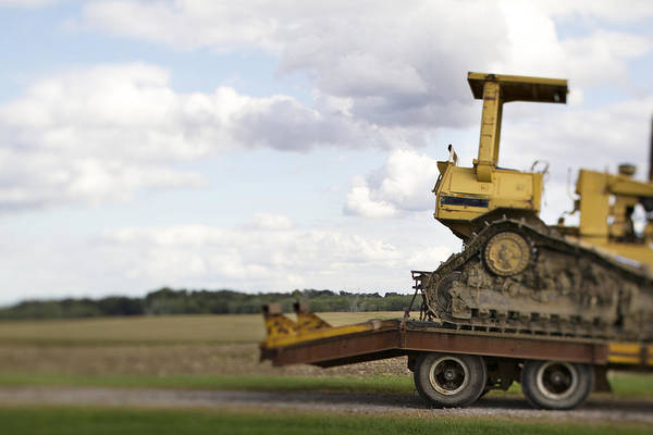 Excavator Photograph - Farming In The Usa. A Bulldozer A Large by Christian Scully