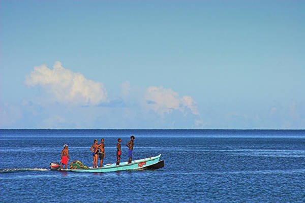 Wall Art - Photograph - Fishermen And Canoe- St Lucia by Chester Williams