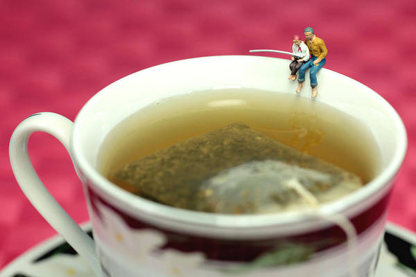 Jasmine Tea Photograph - Fishing At The Edge Of A Cup Of Tea by Paul Ge